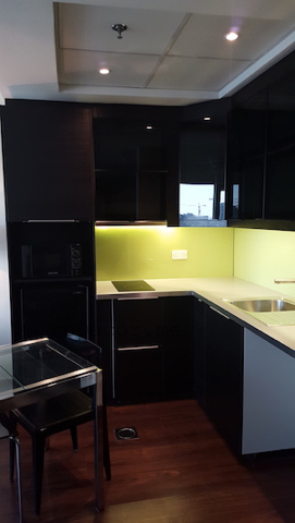 black kitchen ikea, yellow back splash glass, small space living, small dining, entrance, small living, entrance, mirror, enlarge space, wooden flooring, living small homes, studio before, small place design, layout, kitchen remodelling, black kitchen with yellow splash back, design by erika pace, dubai, burj nujoom studio