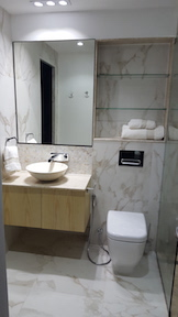 bathroom fit out dubai, old greens bathroom renovation, remodelling, design, modern, marble, walk in shower, dubai, marble basin, built in shower shelves