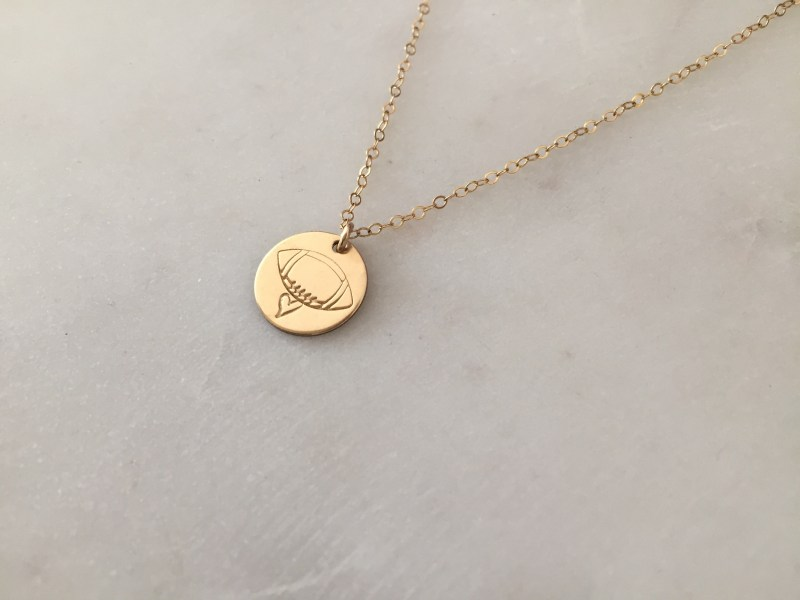 gold football necklace - hand stamped