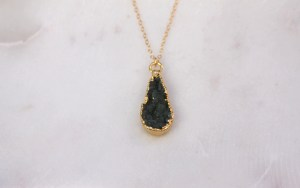 gold necklace with a teardrop druzy pendant