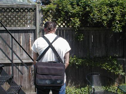 Modify your laptop bag to rest on your back, rather than your side