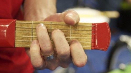 Would you use a practice guitar that fits in your pocket?