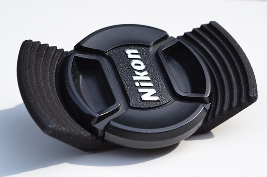 Stow-Away Lens Cap Holder keeps track of your cap