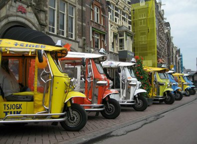 Electric Tuk Tuk comes to Europe – doors? we don't need no stinkin' doors…