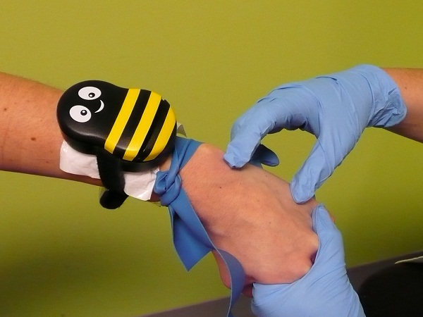 Buzzy is a tourniquet for kids that will take away the sting from shots