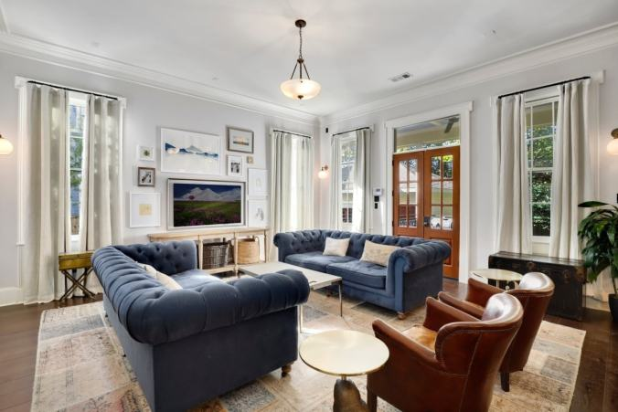 Clean living room with blue couch