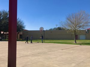 Students at Jimmy Carter Early College High School have fun in the basketball court during lunch.