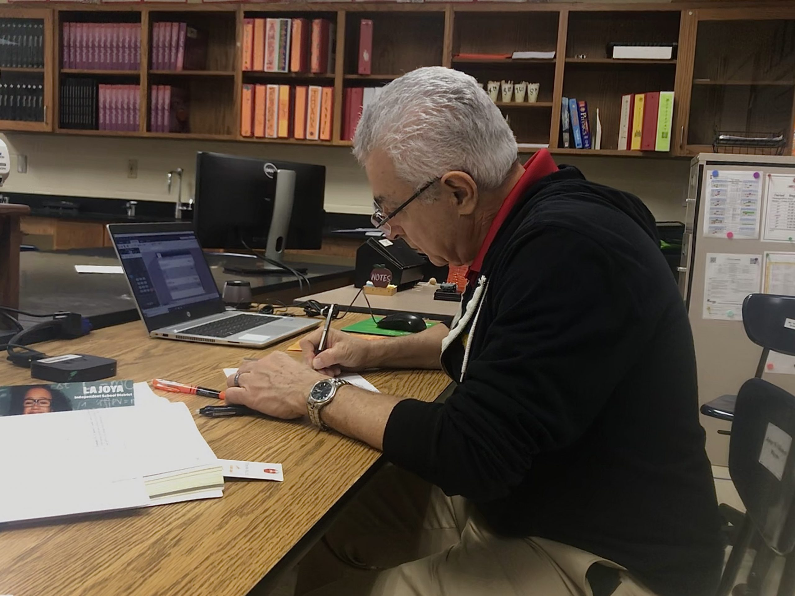 Teacher Villarreal works on his lesson plan for students.