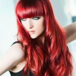 Long red hairstyle with bangs