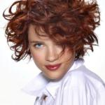 Curly bob hairstyle with copper highlights