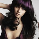 Long hairstyle with bangs and shades of dark egg plant hair color