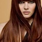 Long brown copper hairstyle with bangs