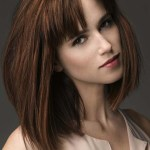 Medium dark auburn bob hairstyle with bangs