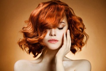 Curly copper bob with side parting