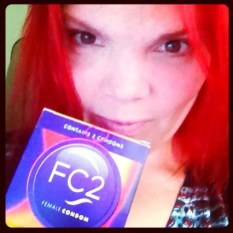 JoEllen holding a box of FC2 condoms