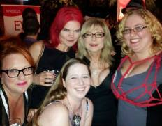 5 women posing at a party: JoEllen, Elle Chase, Nina Hartley, Ashley Manta, Kali Morgan