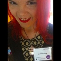 JoEllen wearing a name badge for the Playground Conference