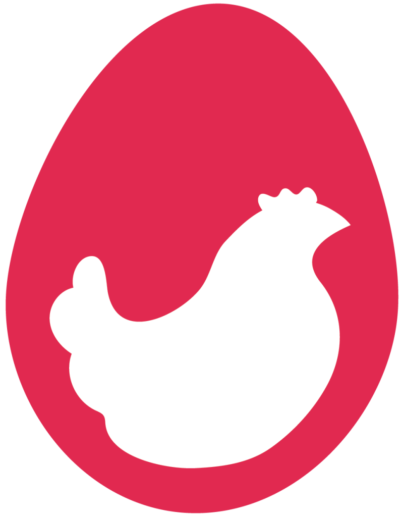 The Red Hen Project white hen in a red egg