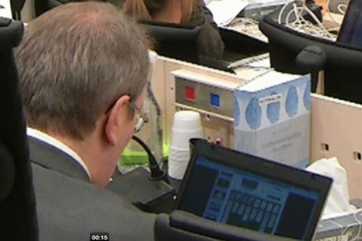 Judge caught playing solitaire in Norway court during mass killer Breivik's trial