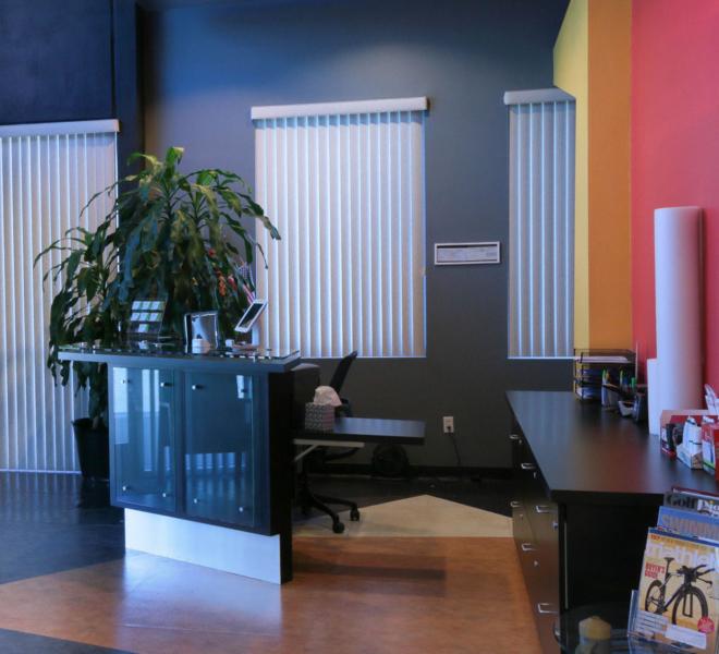 Entrance of Redlands Spine and Sport - Large windows with modern desk