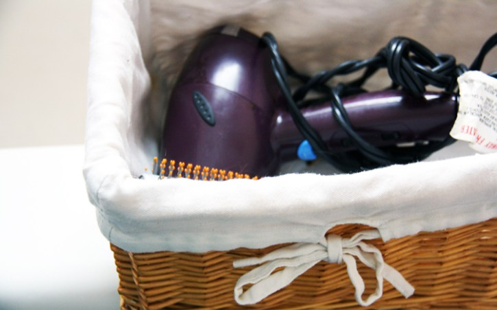 Basket holding a hair dryer | redleafstyle.com