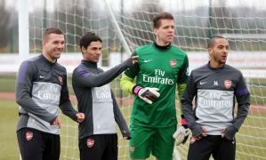 Now that's weird: Four Arsenal players get featured in awkward training ground advert