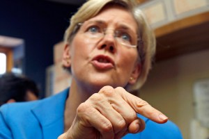 Elizabeth Warren speaks with voters as she campaigns after announcing her candidacy for the U.S. Senate in Framingham