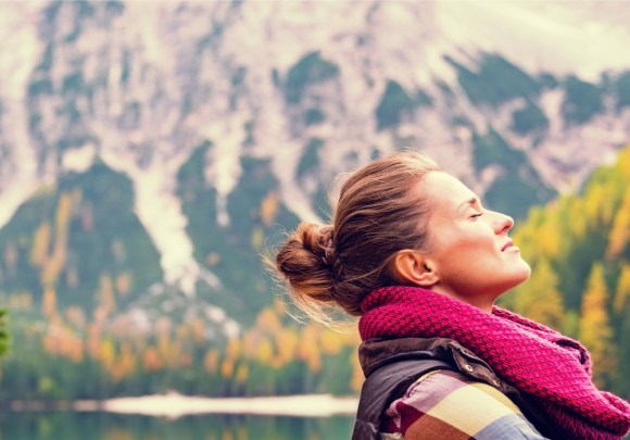 Portrait of relaxed young woman on lake braies in south tyrol, italy