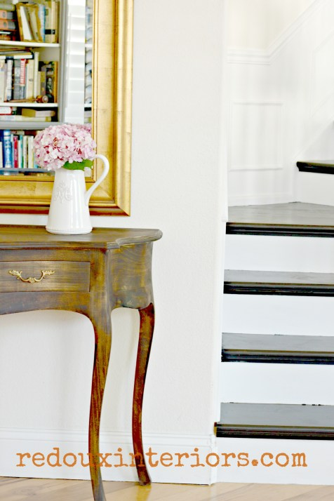 Black and white stairs and french stained entry table peek redouxinteriors