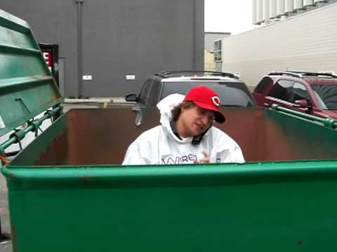 Man in Dumpster on phone