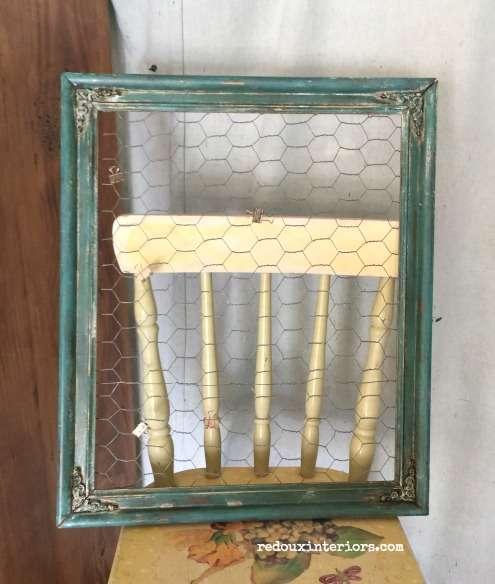 frame with chicken wire found in garbage redouxinteriors