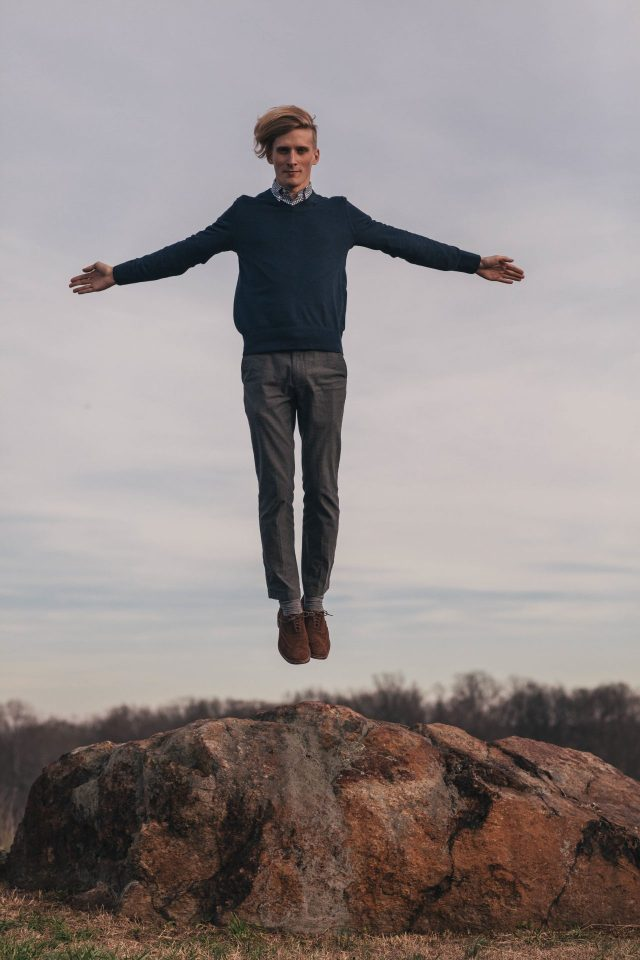man-levitating-over-some-rocks