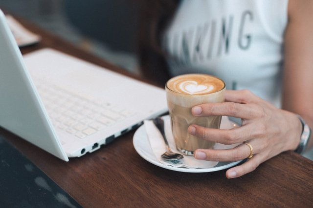 woman-with-coffee-and-laptop-working