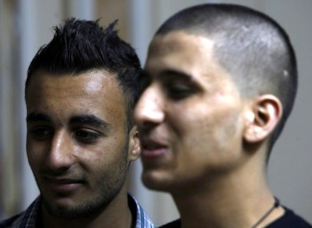 "The man on the left is wearing a  hairstyle deemed ""obscene"" by Hamas, and on the right is a man with his head shaved by Hamas police as punishment for wearing the ""wrong"" hairstyle"