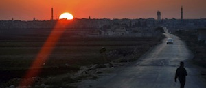 Long winding road in Syria against the background of a setting Sun