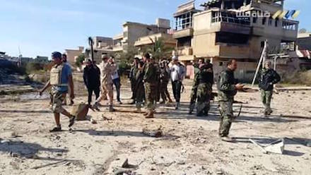 Liberated: Libyan army soldiers in Leithi, east Benghazi