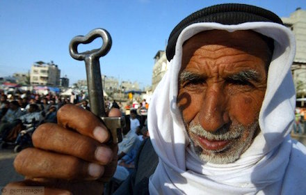 Palestinian man holds the key to his usurped home, as a symbol of the right of return