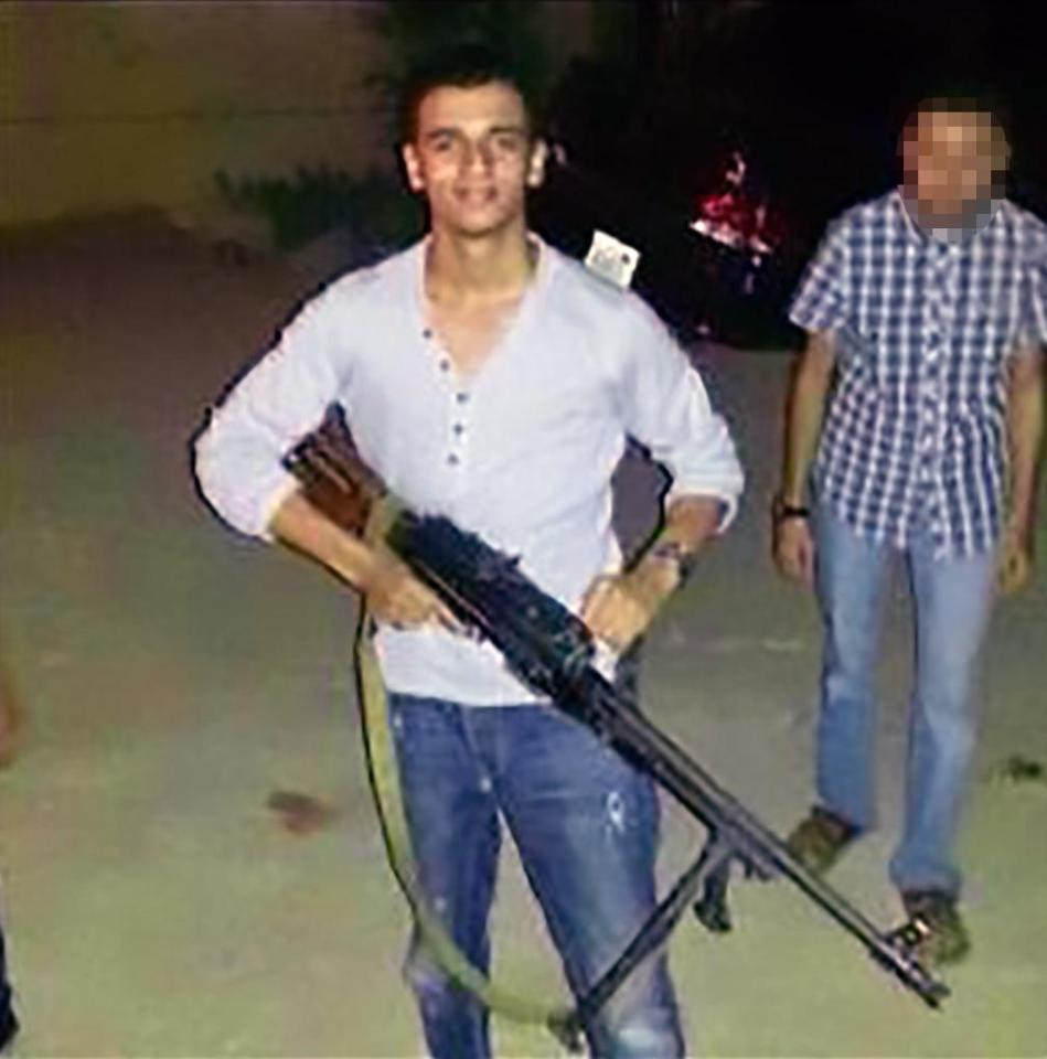 Ismail al-Abedi, the Manchester bomber's older brother, posing with a gun