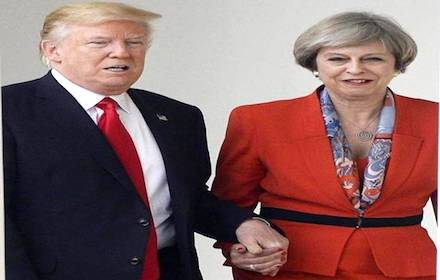 Trump and May holding handsTrump and May holding hands