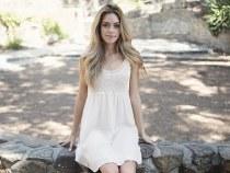 model sitting on stones