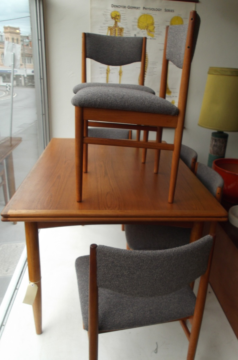 6 Parker teak dining chairs and teak extension table  Red
