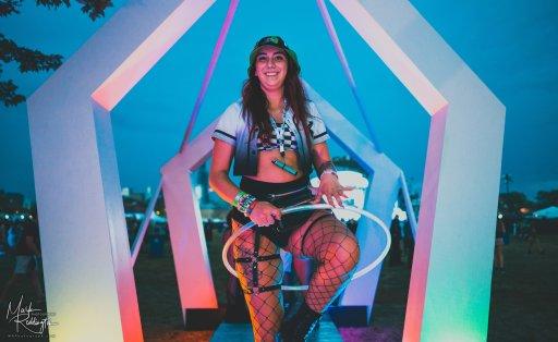Girl hooping on colorful art installation at Spring Awakening Music Festival 2021.