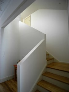 The stairs up to the first storey draw light down into the central corridor of the house and adding a sculptural and functional element.
