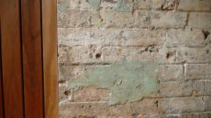 A detail of the feature wall in the Dining Room, showing the characterful aged paintwork contrasted with new timber boards completing the wall.