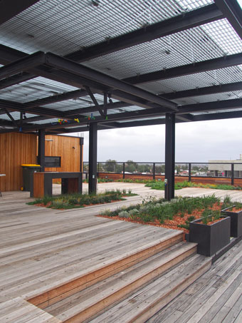 The common roof space, with BBQ, clothes lines, feature garden beds and a great view of Melbourne.