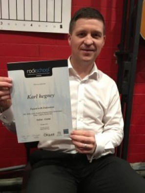 Karl Hegney - distinction at debut guitar grade