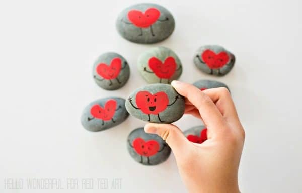 """""""Our Friendship Rocks"""" - what more is there to say? Gorgeous Fringerprint Heart Rocks for Valentines. The perfect Classroom Valentines Gift to make with kids #Valentines #Classroom #rocks #rockpainting"""