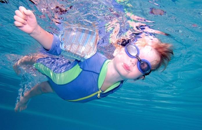 bigstock Young Boy Swimming Underwater 756837