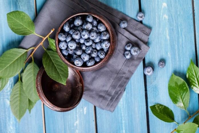 bigstock Freshly picked blueberries in 148882745