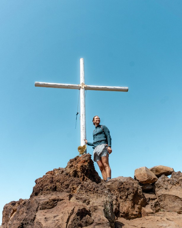 Summit of the Tamaimo-Guama Loop trail with a cross.